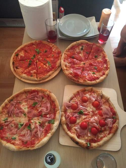 4 pizza's on a table