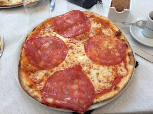 Pizza On a Restaurant Table in Rome Italy